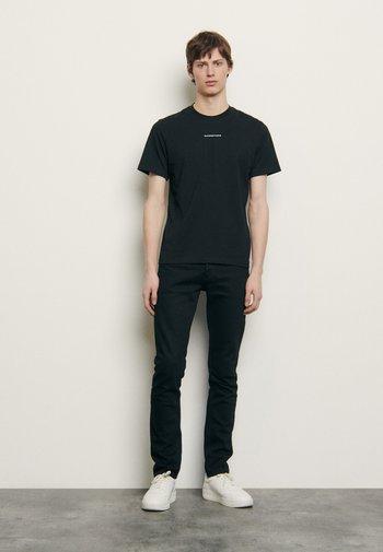 SOLID TEE UNISEX - Basic T-shirt - noir