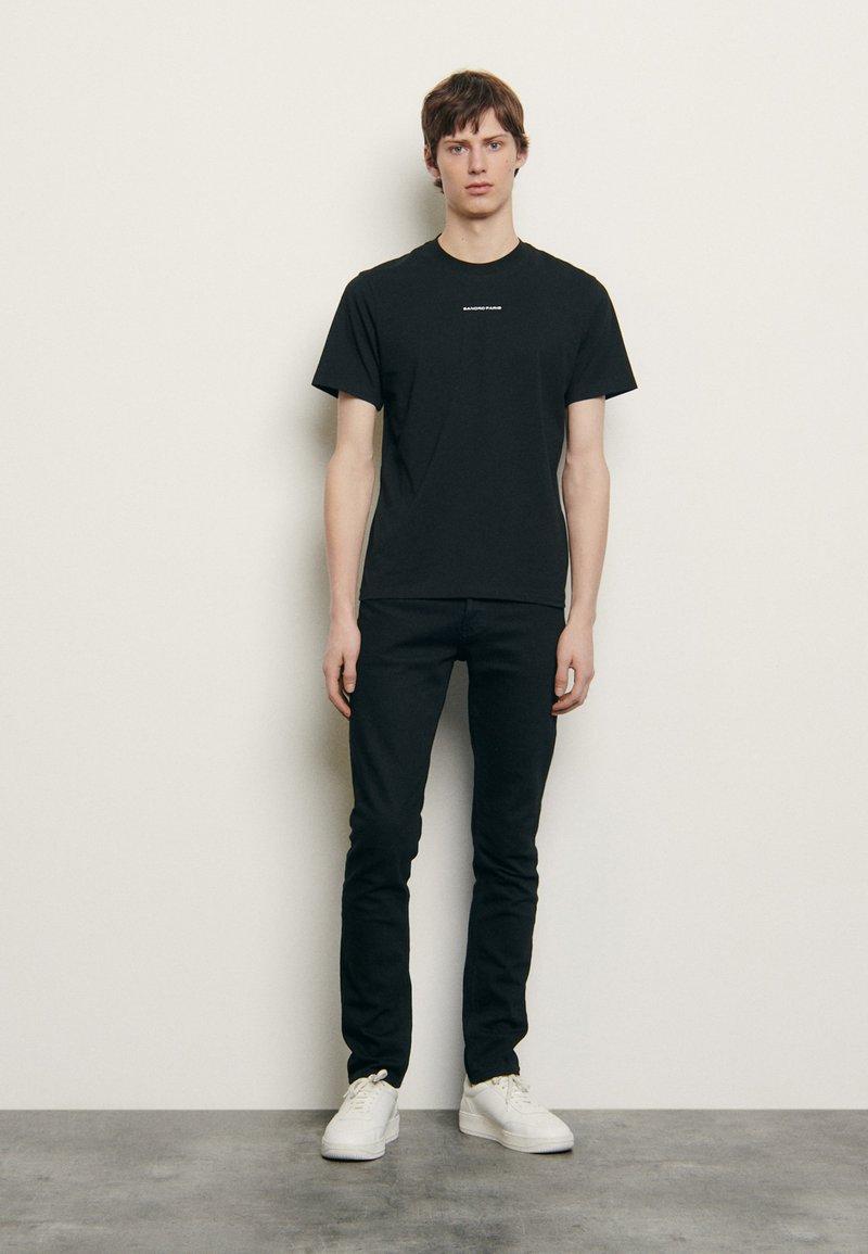 sandro - SOLID TEE UNISEX - Basic T-shirt - noir