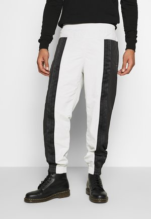 R.Y.V. MODERN SNEAKERHEAD TRACK PANTS - Tracksuit bottoms - black
