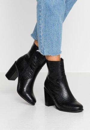 OMM - Kotníková obuv na vysokém podpatku - black
