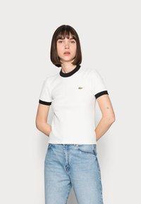 Lacoste LIVE - Print T-shirt - farine/noir - 0