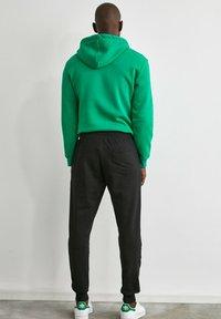 Trendyol - Pantalon de survêtement - black - 2