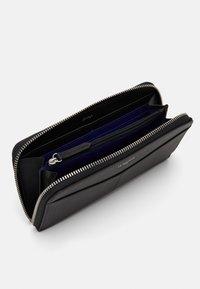 Le Tanneur - CHARLOTTE LONG ZIPPED AROUND WALLET UNISEX - Wallet - noir - 2