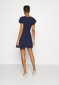 Nly by Nelly - DOUBLE FLOUNCE SLEEVE DRESS - Cocktail dress / Party dress - navy - 2
