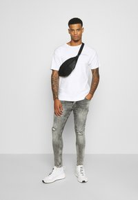Gym King - WASHED RIP AND REPAIR - Jeans Skinny Fit - dark grey - 1