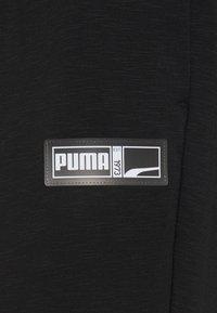 Puma - FRANCHISE PANT - Pantalon de survêtement - black - 2