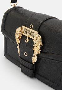 Versace Jeans Couture - BUCKLE SHOULDER BAG - Across body bag - nero - 4