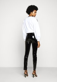 KARL LAGERFELD - PATENT - Leggings - black - 2