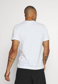 Reebok - STACKED TEE - T-shirts print - white - 2