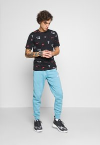 Nike Sportswear - CLUB - Tracksuit bottoms - cerulean/white - 1