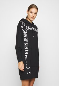 Calvin Klein Jeans - GRID LOGO HOODED DRESS - Day dress - black - 0