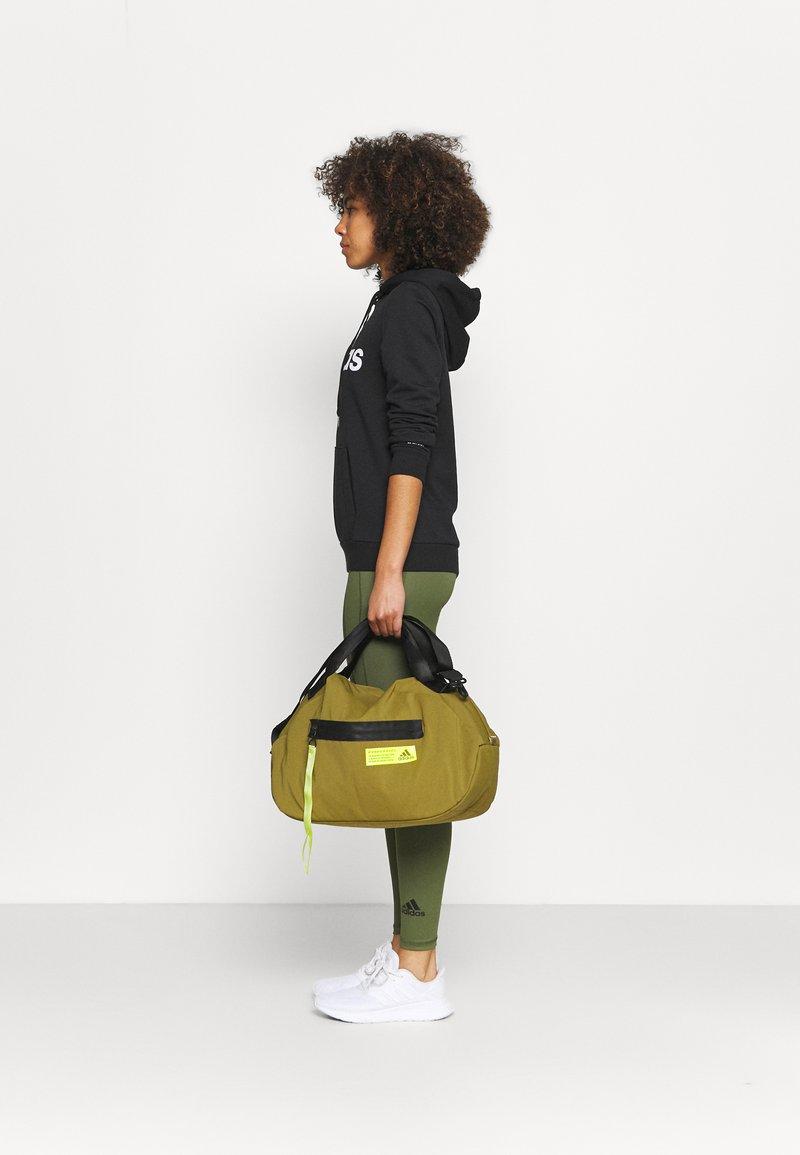 adidas Performance - FAV DUFFEL BAG - Sports bag - wild moss/acid yellow