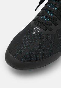 Umbro - VELOCITA VI PRO FG - Moulded stud football boots - black/white/cyan blue - 5