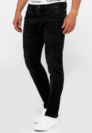 HYDRO FLEX - Slim fit jeans - black