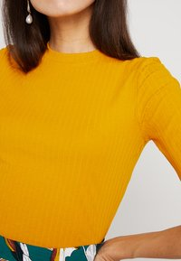 KIOMI - Basic T-shirt - dark yellow - 6