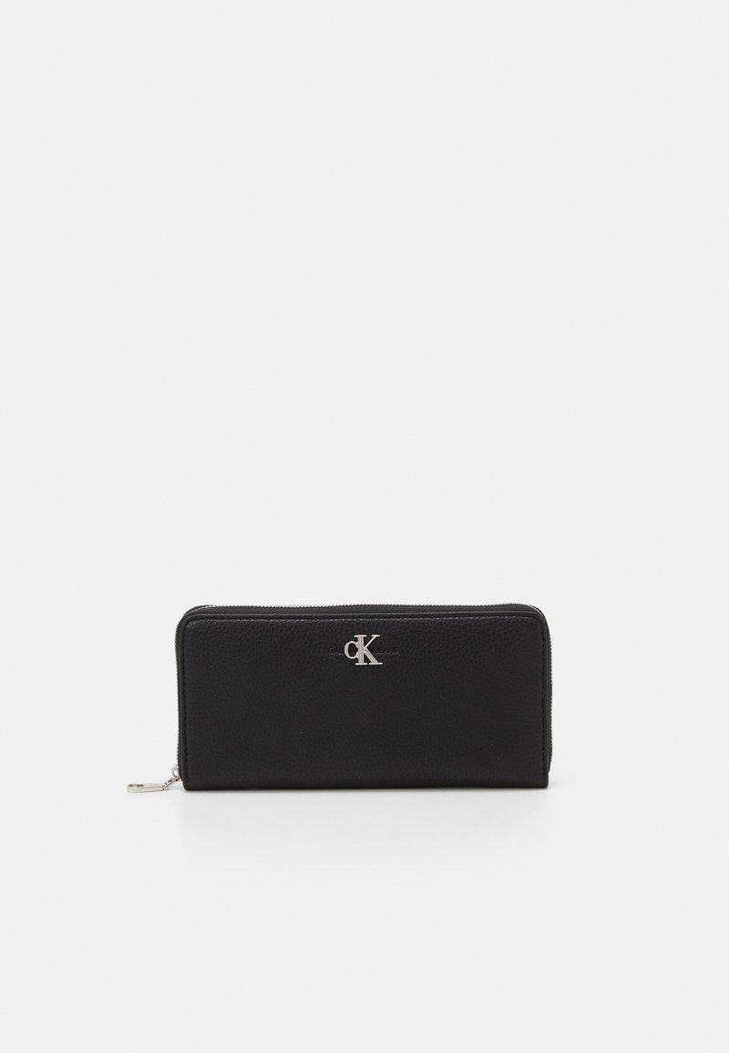 Calvin Klein Jeans - ZIP AROUND - Wallet - black