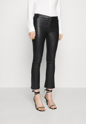 ATHENA - Leather trousers - black