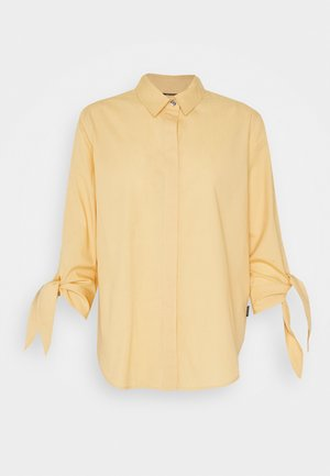 SOFT CUFF  - Button-down blouse - muted yellow
