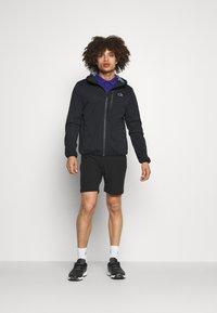 Calvin Klein Golf - ULTRON HOODED JACKET - Waterproof jacket - navy - 1
