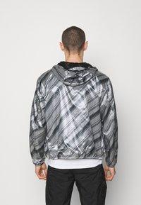 Emporio Armani - BLOUSON JACKET - Waterproof jacket - grey - 2