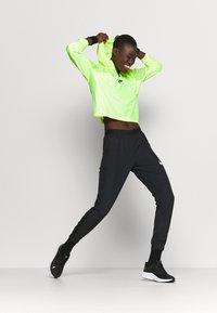 Nike Performance - RUN PANT - Pantalones deportivos - black/grey fog/white - 1