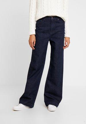 EMONE WIDE - Flared jeans - rinsewash