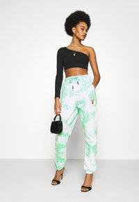 Missguided - PLAYBOY TIE DYE - Pantalones deportivos - mint - 1