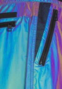 Calvin Klein Jeans - FASHION IRIDESCENT PANT - Tracksuit bottoms - purple - 3