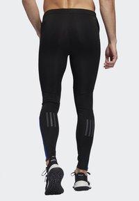 adidas Performance - OWN THE RUN LONG TIGHTS - Caleçon long - black/blue - 1