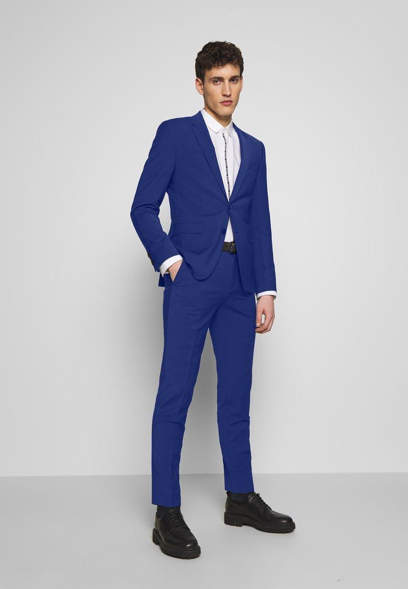 HUGO - ASTIAN HETS - Puku - bright blue
