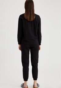 DeFacto - Tracksuit bottoms - black - 2