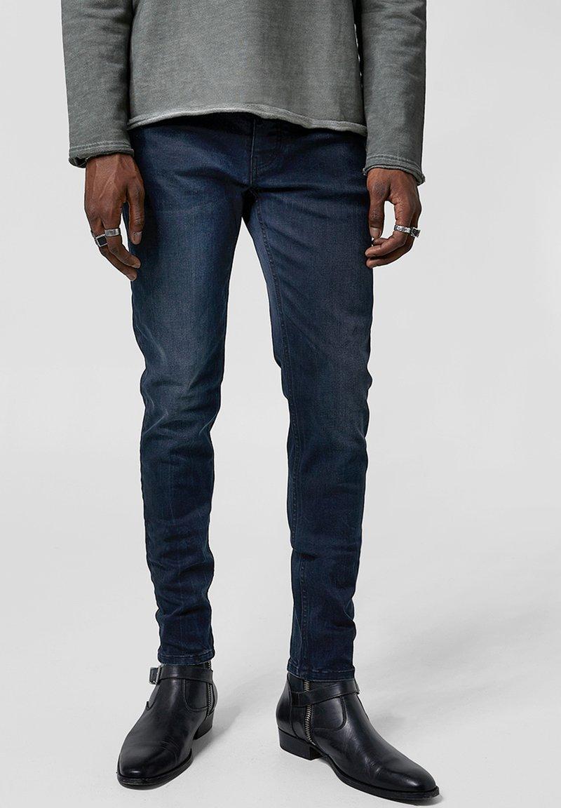 Tigha - MORTY - Slim fit jeans - dark blue