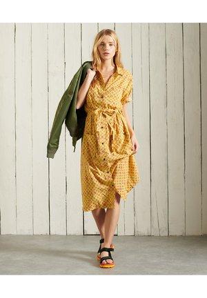 Sukienka koszulowa - yellow print