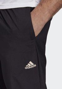 adidas Performance - ADAPT JOGGERS - Träningsbyxor - black - 6
