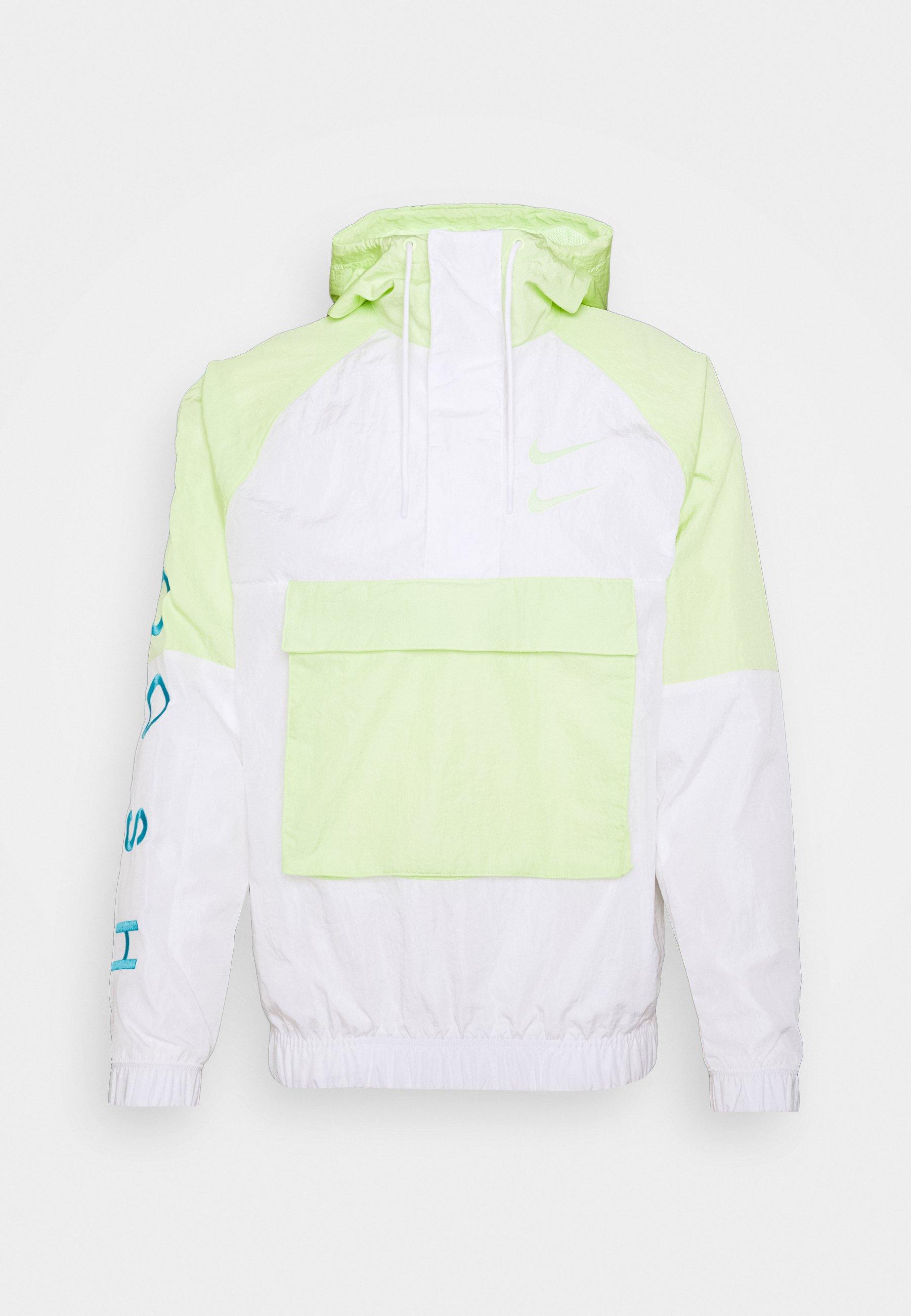 Compañero marca Plausible  Nike Sportswear Cortaviento - barely volt/white/white/volt/blanco -  Zalando.es