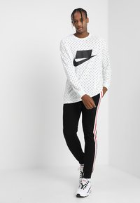 Urban Classics - TERRY TONE SIDE STRIP PANTS - Tracksuit bottoms - black/white/firered - 1