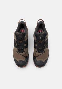 Salomon - XA WILD - Trail running shoes - bungee cord/phantom/burnt brick - 3