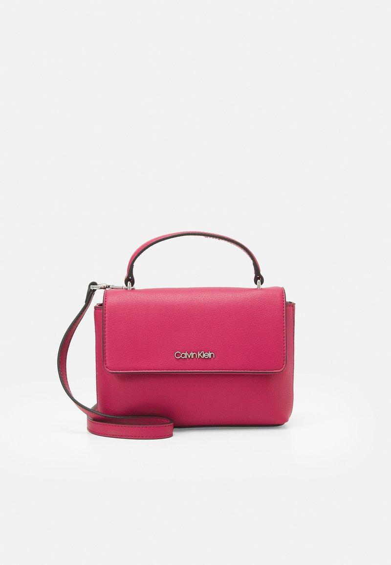 Calvin Klein - FLAP MINI BAG TOP HANDLE - Handbag - cerise