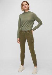 Marc O'Polo - LULEA SLIM MID WAIST  - Slim fit jeans - dark green - 1