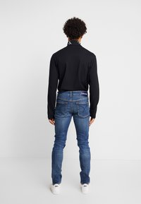 Calvin Klein Jeans - TAPER - Jeans Tapered Fit - blue - 2