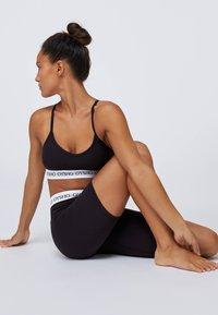 OYSHO - Sports shorts - black - 3