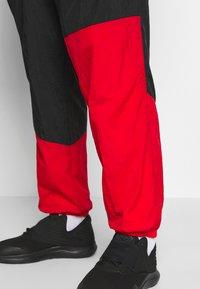 Nike Performance - FLIGHT TRACKSUIT - Tuta - black/white/university red - 4
