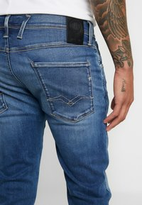 Replay - ANBASS HYPERFLEX BIO - Slim fit jeans - medium blue - 5