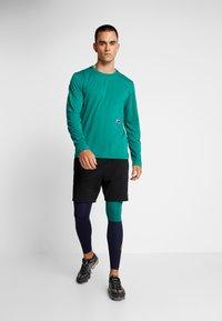 Nike Performance - Legginsy - blackened blue/mystic green/kumquat - 1