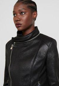 Desigual - BROWARD - Imitatieleren jas - black - 4