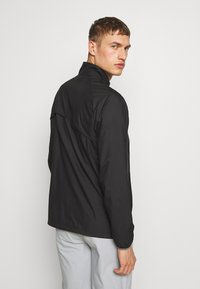 Puma Golf - ZEPHYR JACKET - Větrovka - black - 2