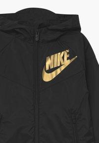 Nike Sportswear - Training jacket - black/gold - 2
