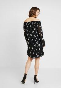 NA-KD - COWGIRL FLORAL PRINTED OFF SHOULDER DRESS - Day dress - black/white - 3