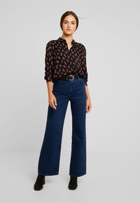 Monki - NADINA BLOUSE - Button-down blouse - black dark - 1