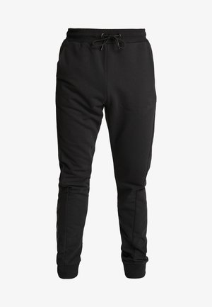 HMLISAM REGULAR PANTS - Spodnie treningowe - black